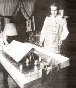 Photo of Rudy Jones and model of Tabernacle he and Polly built